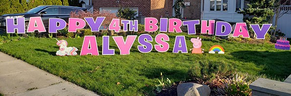 Large pink and purple birthday lawn sign