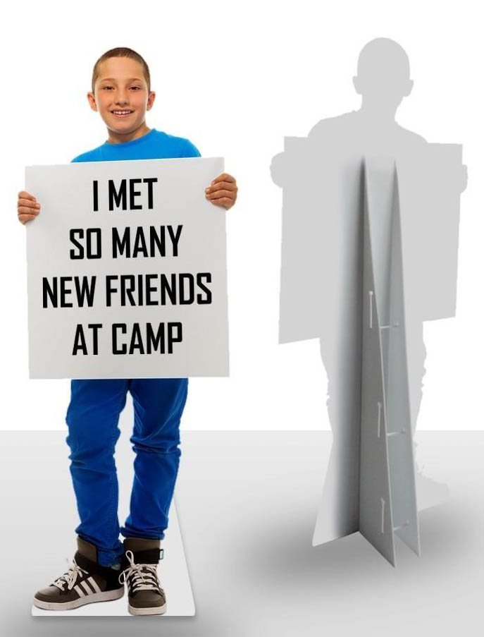 Life-size cardboard cutout of child holding sign