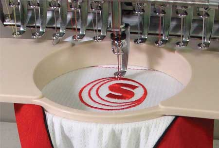 Embroidery machine embroidering garment